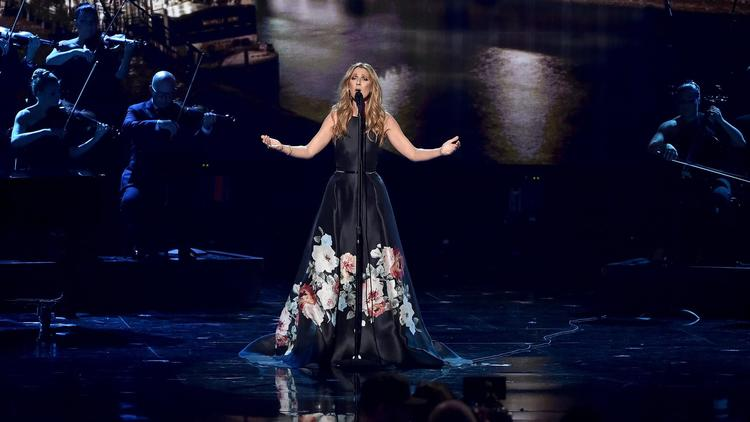 Celine Dion performs at the 2015 American Music Awards at the Microsoft Theater in Los Angeles.  (Kevin Winter / Getty Images)