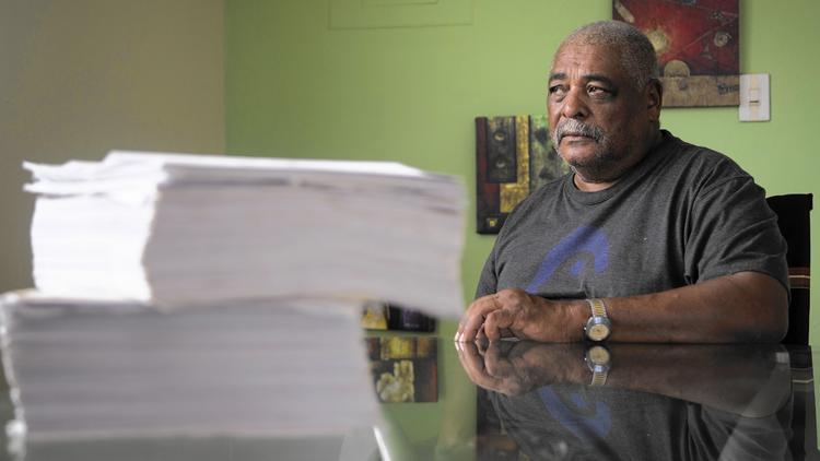 Ivan Figueroa with the paperwork from his VA appeals
