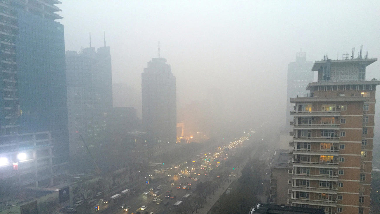 Smog hangs over Beijing's main boulevard, Chang'an Avenue, looking west toward the Forbidden City. (Stuart Leavenworth / TNS)
