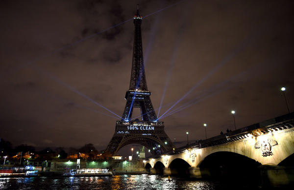 The Eiffel Tower lit up with messages to prevent global warming during the first day of the talks. (Getty Images)