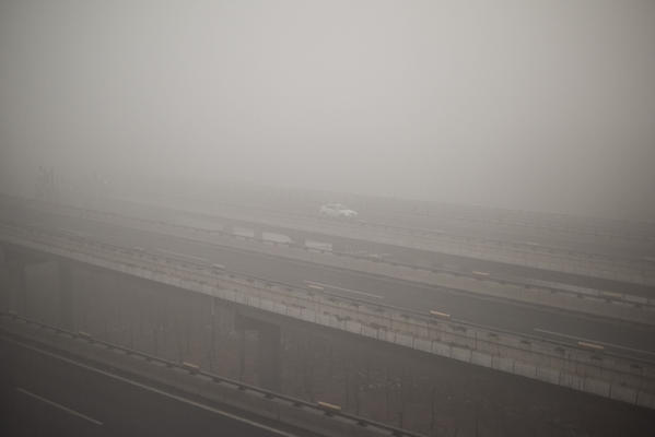 Smog that was measured at nearly 24 times safe levels clouds a road in China on Dec. 1. (Getty Images)