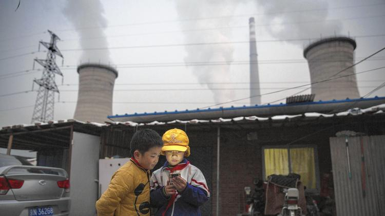 A coal-fired power plant on the outskirts of Beijing. (Kevin Frayer / Getty Images) ()