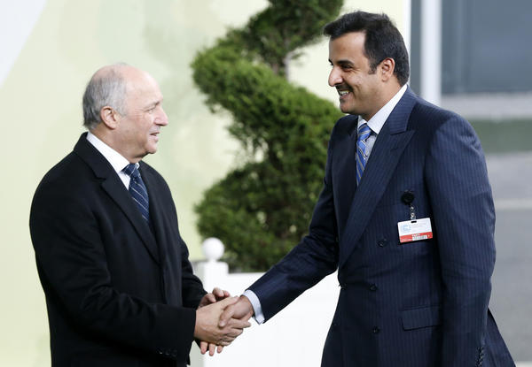 French Foreign Affairs Minister Laurent Fabius, left, greets Qatar's Emir Tamim bin Hamad Al Thani as he arrives for the global climate summit. (Associated Press)