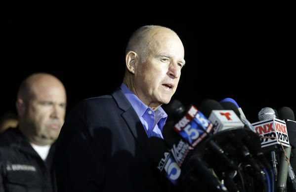 Gov. Jerry Brown speaks to reporters on Thursday near the site of the mass shooting in San Bernardino. (Chris Carlson / Associated Press)