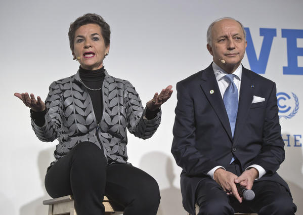U.N. climate chief Christiana Figueres and French Foreign Minister Laurent Fabius. (Michel Euler / Associated Press)