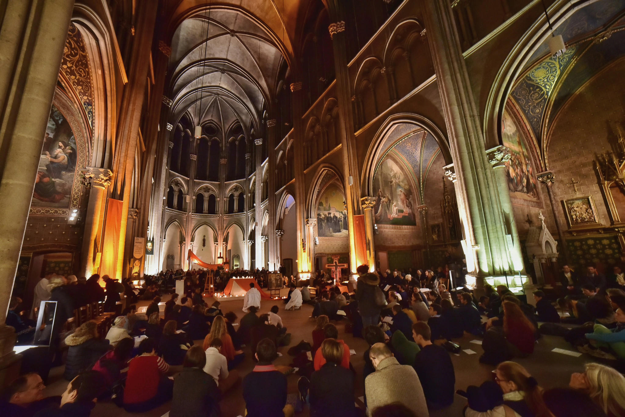 People in Paris' St. Ignatius church Saturday pray for world leaders to curb global warming. (Marie Renaux / Taize via Associated Press)