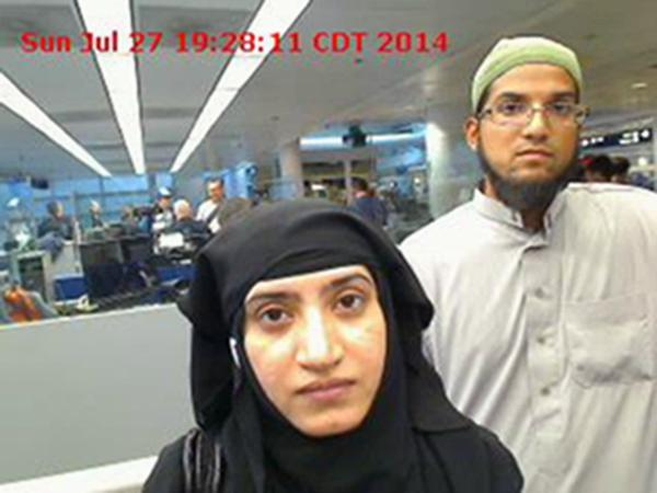 Tashfeen Malik and Syed Farook in 2014 (Associated Press / U.S. Customs and Border Protection)