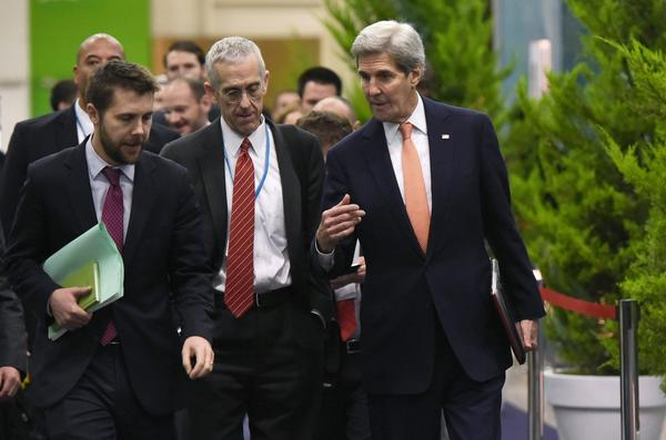 U.S. Secretary of State John Kerry, right, walks with White House senior advisor Brian Deese, left, and U.S. Special Envoy for Climate Change Todd Stern on Thursday. (Mandel Ngan/AFP/Getty Images)