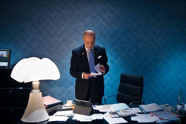 French Foreign Minister Laurent Fabius in his office at the United Nations summit. (Martin Bureau/AFP/Getty Images)