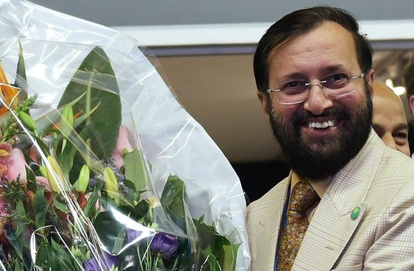 India's Environment Minister Prakash Javadekar presents a bouquet at the conference. (Mandel Ngan / Pool via AP)