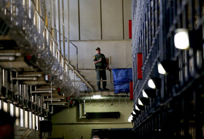 A guard stands watch over the condemned prisoners housed on death row at San Quentin State Prison on Dec. 29, 2015.