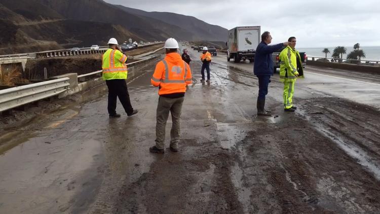 Heavy rains flood roads and jam commutes
