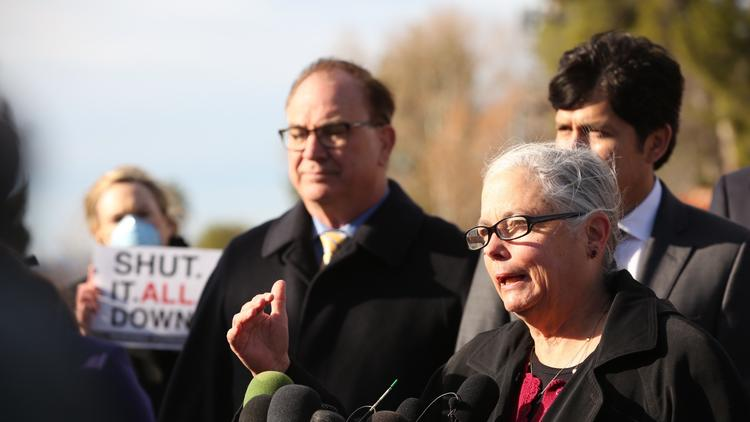 State Sens. Fran Pavley, center, Bob Huff, left, and Kevin de León, right, hold a news conference outside Southern California Gas Co.'s Aliso Canyon gate in Porter Ranch on Monday morning, where they announced a legislative package that would address the ongoing gas leak. (Al Seib / Los Angeles Times)