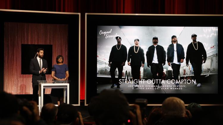 """Actor John Krasinski and Academy President Cheryl Boone Isaacs announce """"Straight Outta Compton"""" as a nominee for best original screenplay. (Al Seib / Los Angeles Times)"""