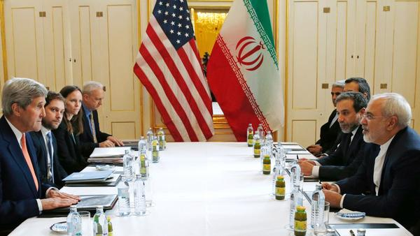 U.S. Secretary of State John F. Kerry, left, with Iranian Foreign Minister Mohammad Javad Zarif, right, in Vienna on Saturday. (AFP / Getty Images) None