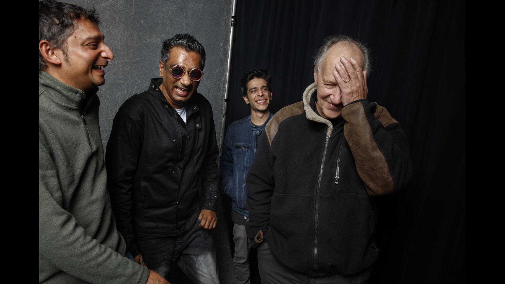 Naman Ramachandran, left, Q., and Shashank Arora with Werner Herzog. (Jay L. Clendenin / Los Angeles Times)