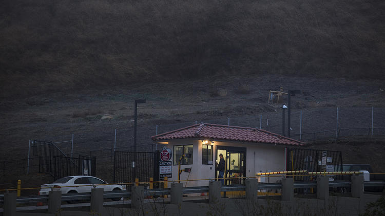 A security guard stands at the entry point to Southern California Gas Co.'s Aliso Canyon storage facility near Porter Ranch. (Brian van der Brug / Los Angeles Times)