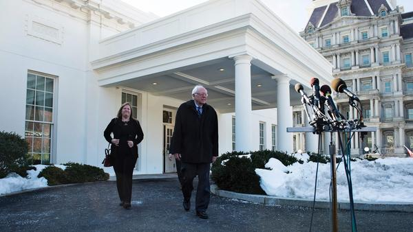 Bernie Sanders and his wife outside President Obama at the White House on Wednesday. (Brendan Smialowski / AFP/Getty Images)
