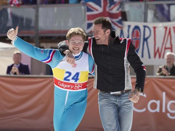 """Actors Taron Egerton, left, and Hugh Jackman appear in a scene from """"Eddie the Eagle."""" (20th Century Fox)"""