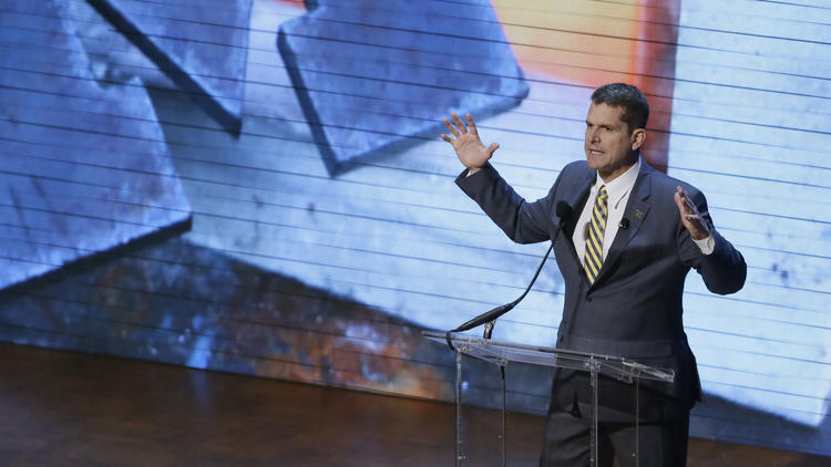 """Michigan Coach Jim Harbaugh talks to fans at the school's """"Signing With the Stars"""" event Feb. 3. (Carlos Osorio / Associated Press)"""