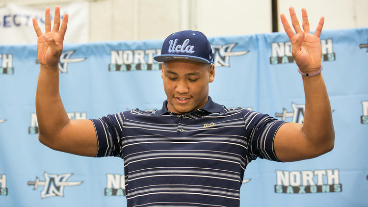 North Torrance High linebacker Mique Juarez announces his committment to UCLA during National signing day on Feb. 3. (Marcus Yam / Los Angeles Times)