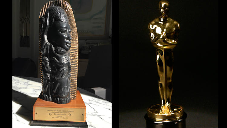 A Tree of Life Award, left, and an Oscar statuette. (Debbie Allen / Charles Rex Arbogast/Associated Press)
