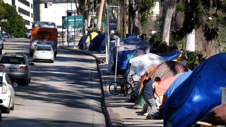 Homeless people's tents line a street in downtown L.A. on Jan. 26. (Richard Vogel / Associated Press)