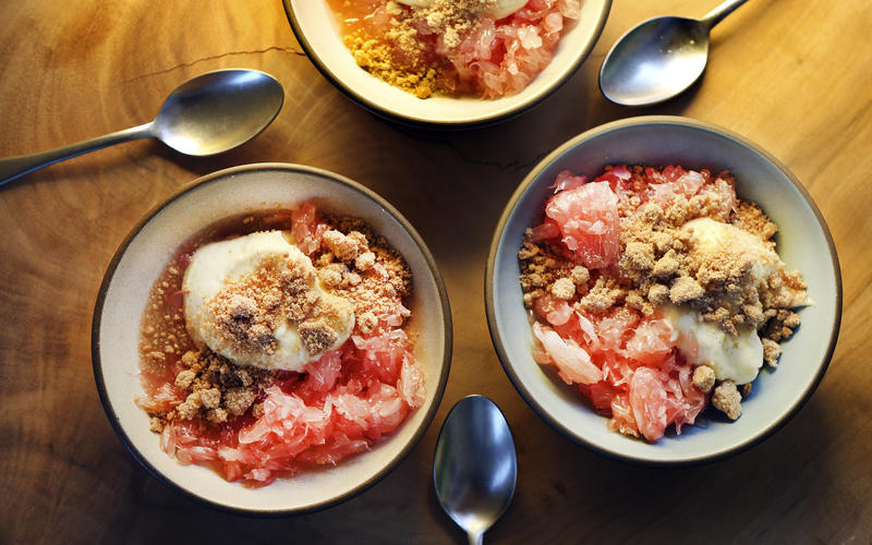 Pomelo with yogurt cream and sweet crumbles