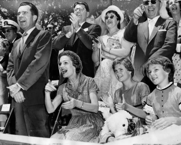 In June 1959, Vice President Richard Nixon, his wife, Pat, and daughters Patricia and Julie enjoy a Disneyland parade.