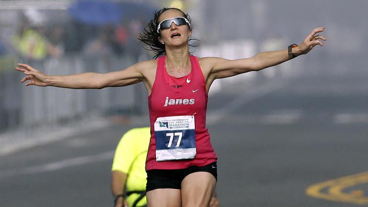 Julia Budniak nears the finish line of the L.A. Marathon. (Chris Carlson / Associated Press)