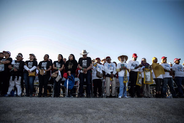 Pilgrims stand at a levee on the U.S. side of the border during the pope's Mass in Ciudad Juarez. (Robert Gauthier / Los Angeles Times)