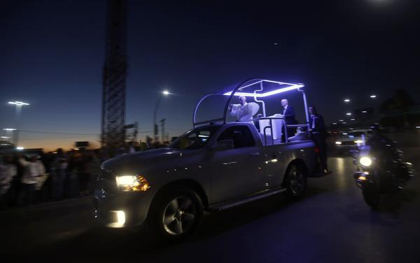 Pope Francis waves from the popemobile as he heads to the airport in Ciudad Juarez, Mexico, to return to the Vatican. (Julio Cesar Aguilar/AFP/Getty Images)