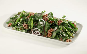 Salad of beet greens with walnuts