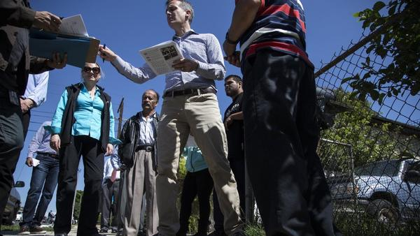 Mayor Eric Garcetti chats with residents in Boyle Heights on Saturday about getting free testing to check their yards for possible lead contamination.(Gina Ferazzi / Los Angeles Times)
