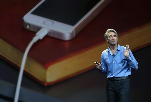 Apple executive Craig Federighi speaks during an Apple media event in 2014.