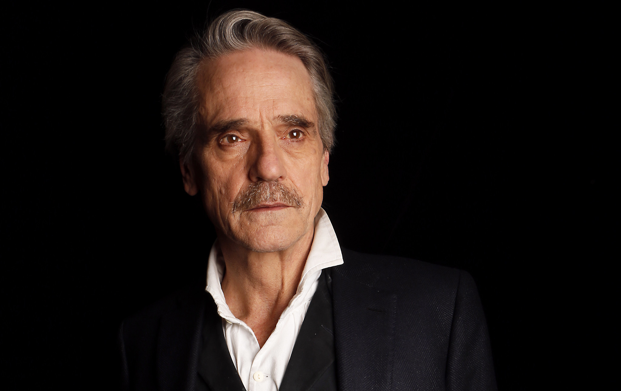 Jeremy Irons at your service as Alfred, a very different ...  Jeremy Irons at...