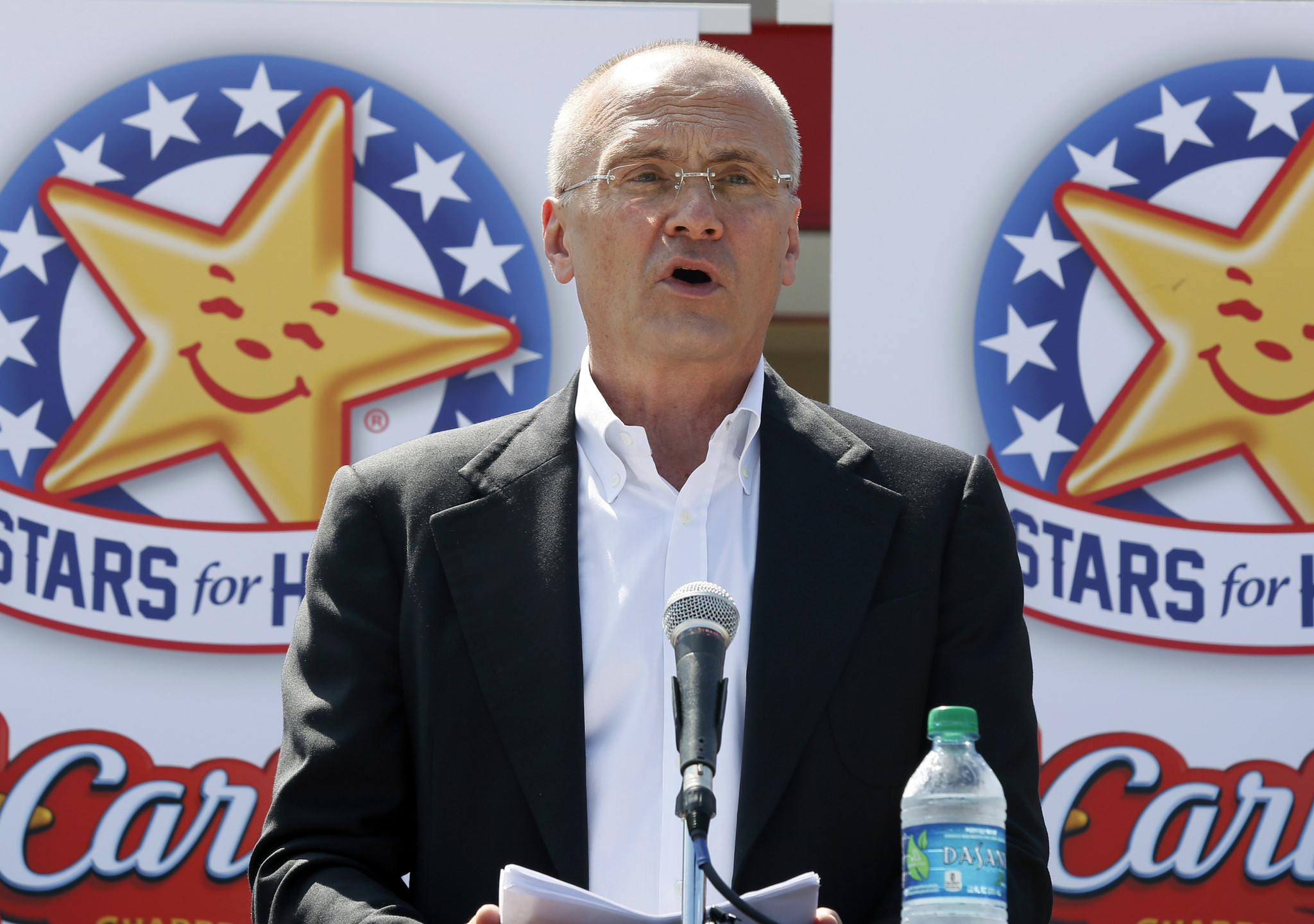 Andy Puzder, CEO of Carl's Jr. parent CKE Restaurants, at a news conference in Texas in 2014.