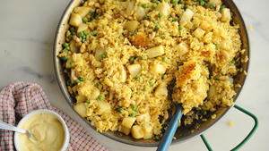 Paella with turnips, peas and spring onions
