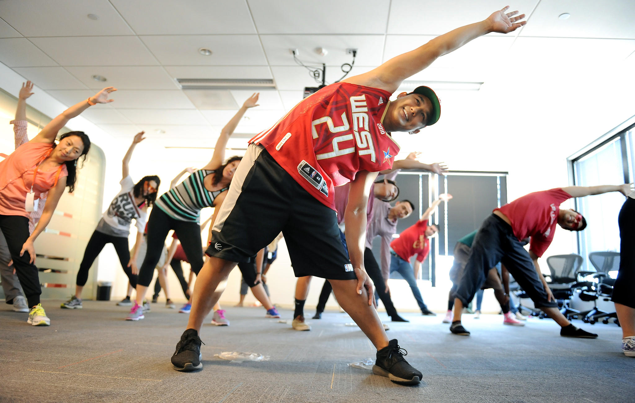 Limzer Lagrimas, center, teaches a hip hop dance class to fellow Edmunds.com employees during the company's