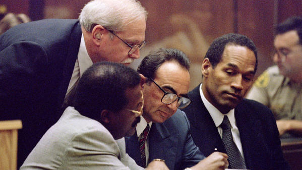 Johnnie Cochran, from left, Gerald Uelmen, Robert Shapiro and defendant O.J. Simpson confer during the trial.