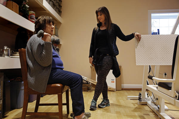 Personal trainer Peggy Hayes works with Mary Jane King, one of her favorite clients. King and her husband, Alfred, helped shape Hayes' political views.