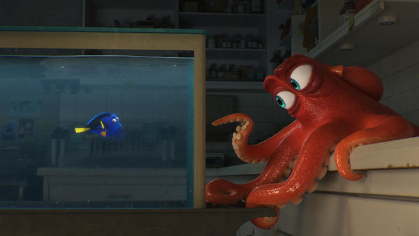 Dory, voiced by Ellen DeGeneres, encounters an octopus named Hank, voiced by Ed O'Neill, in
