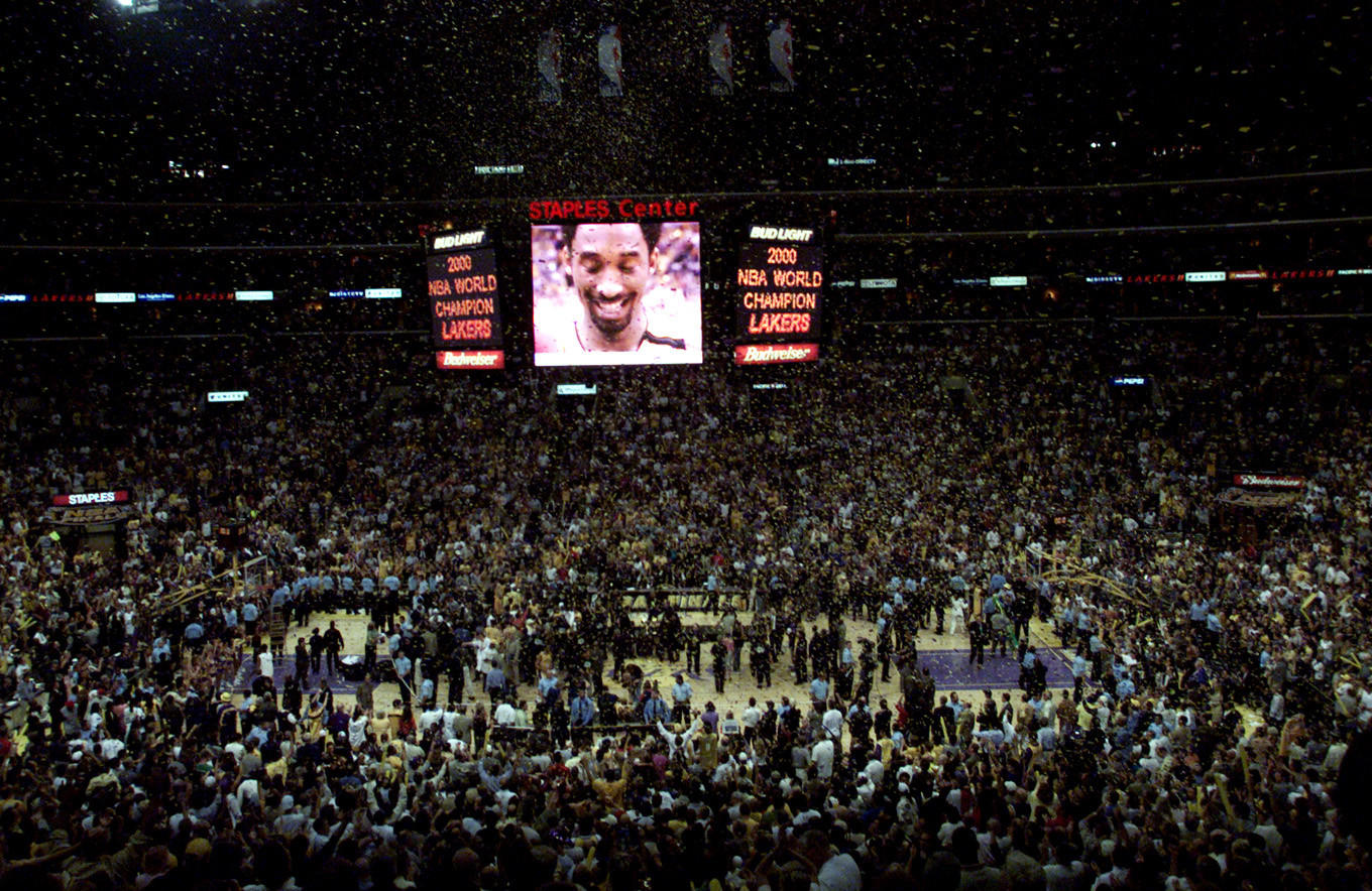 The celebration begins at Staples Center after the Lakers beat the Pacers in the 2000 NBA Finals.