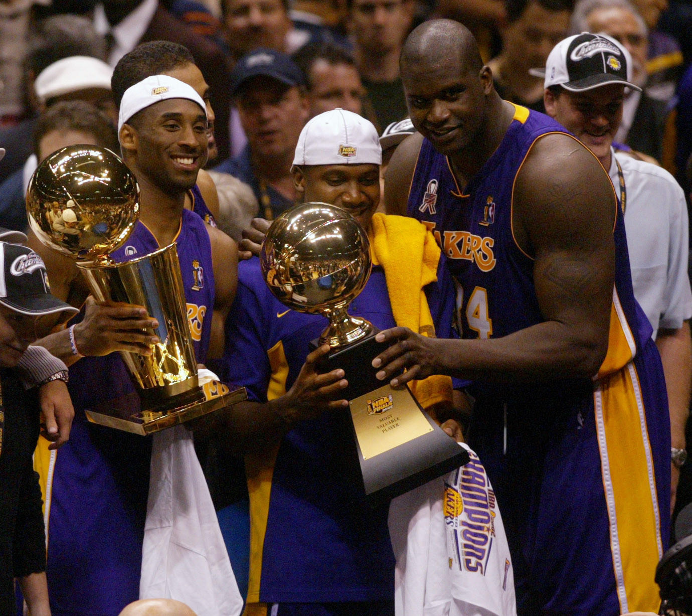 Kobe, Lindsey Hunter and Shaquille O'Neal celebrate in the 2002 NBA Finals.