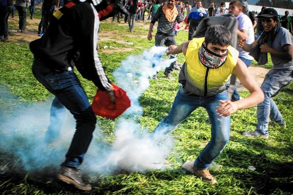 The bravest of the migrants picked up tear-gas canisters and lobbed them back at the Macedonian border troops.