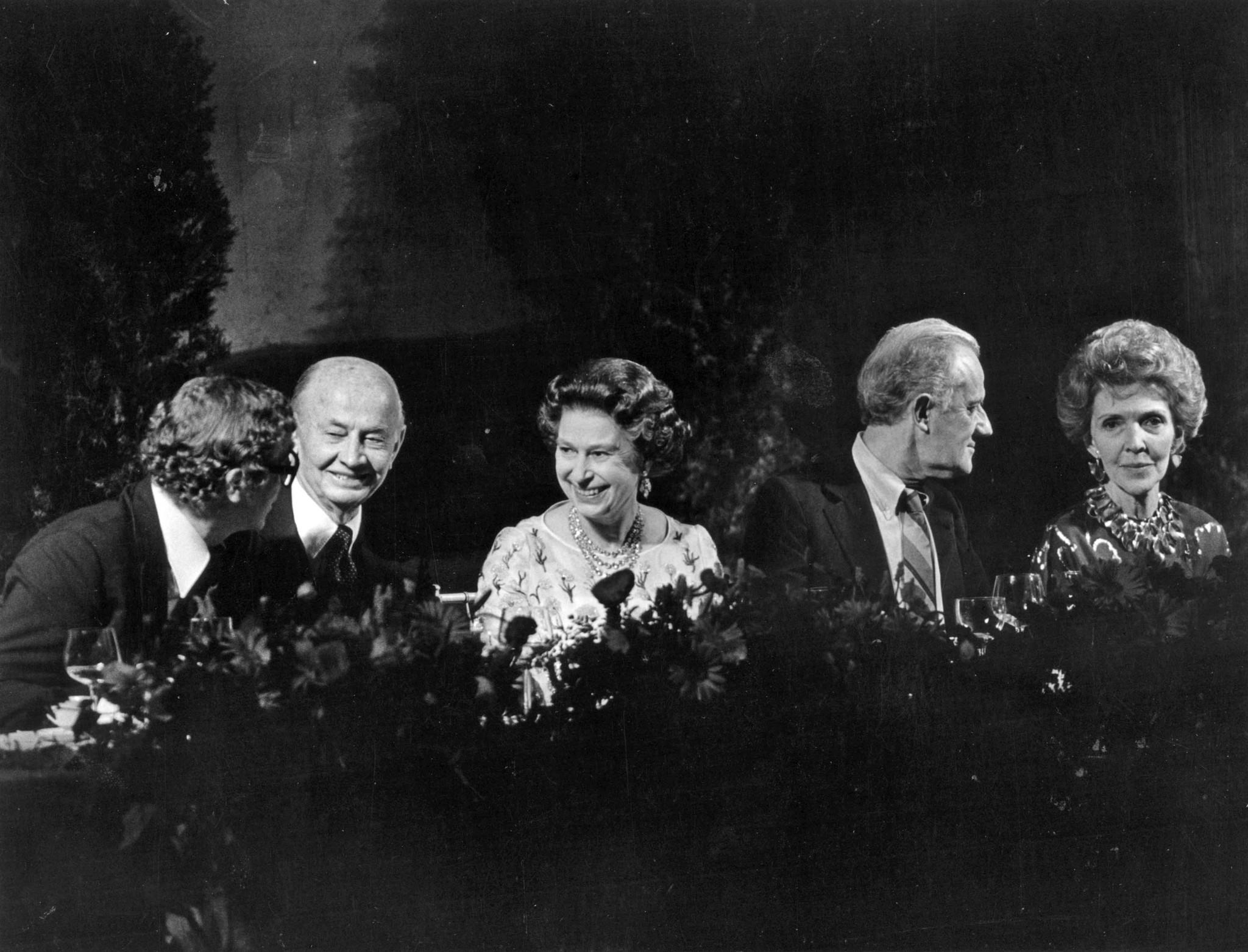 Feb. 27, 1983: During banquet at 20th CenturyFox's Sound Stage 9, Queen Elizabeth II, center, jokes with actor Michael Caine, left. On the right is Tony Richardson and Nancy Reagan. Holmes Tuttle sits between Caine and the queen. This photo was published in the March 1, 1983, Los Angeles Times View section.