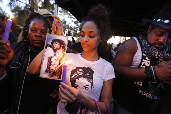 Julya Baer honors Prince in Leimert Park, where fans laughed, cried and danced in remembrance of the music legend. (Barbara Davidson / Los Angeles Times)