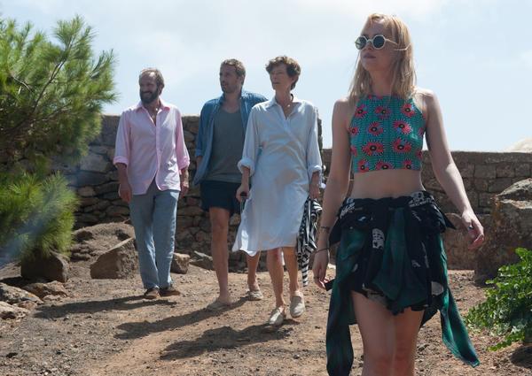 Ralph Fiennes as Harry, Matthias Schoenaerts as Paul, Tilda Swinton as Marianne and Dakota Johnson as Penelope in