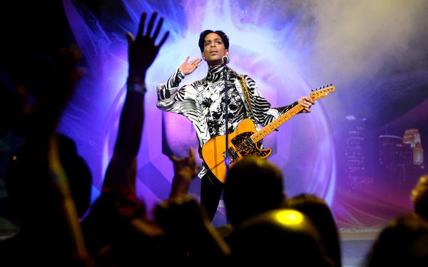 Prince, shown performing in Los Angeles in 2009, died Thursday at age 57. (Kristian Dowling / Getty Images)