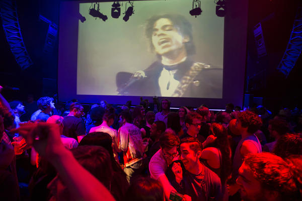 "A crowd pays tribute to Prince inside the club First Avenue in Minneapolis, where ""Purple Rain"" was shown late Thursday (Renee Jones Schneider / Star Tribune / Associated Press)"
